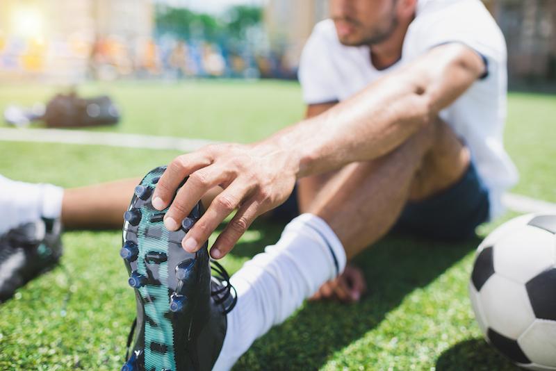 Dehnen als Vorbereitung für Fußball